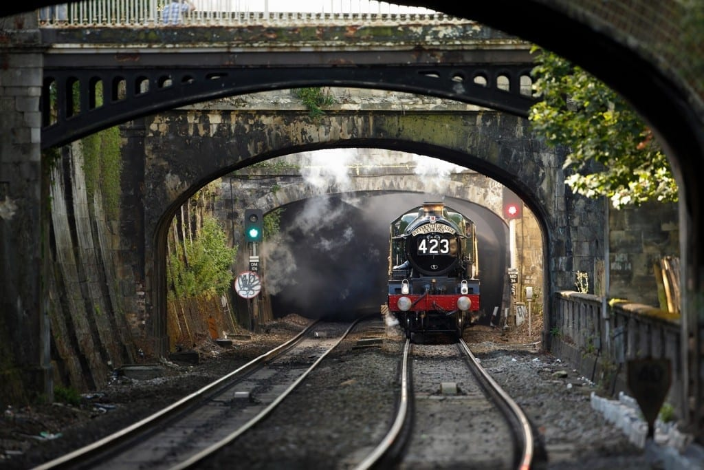 EGGB1W The Weymouth Seaside Express passes Sydney Gardens as it leaves Bath Spa. Image shot 08/2013. Exact date unknown.
