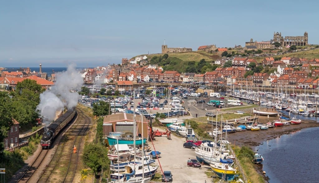 CW5PPB Whitby Yorkshire UK View to Abbey from New Bridge over town with steam train