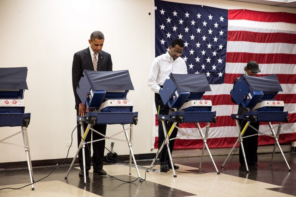 President Barack Obama casts his ballot during early voting at the Martin Luther King Jr. Community Center in Chicago, Ill., Oct. 25, 2012. (Official White House Photo by Pete Souza) This official White House photograph is being made available only for publication by news organizations and/or for personal use printing by the subject(s) of the photograph. The photograph may not be manipulated in any way and may not be used in commercial or political materials, advertisements, emails, products, promotions that in any way suggests approval or endorsement of the President, the First Family, or the White House.