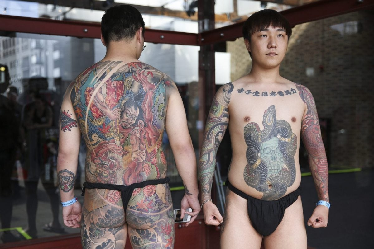 Tattoo enthusiasts, Meigin and Seoyul from South Korea, at the London Tattoo convention in Shadwell, East London. . 23 September 2016.
