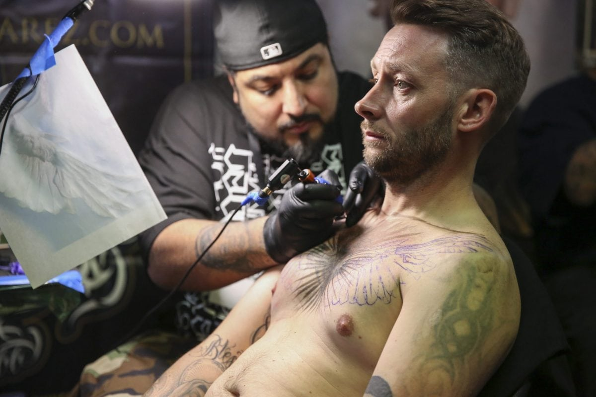 Tattooing at the London Tattoo convention in Shadwell, East London. . 23 September 2016.
