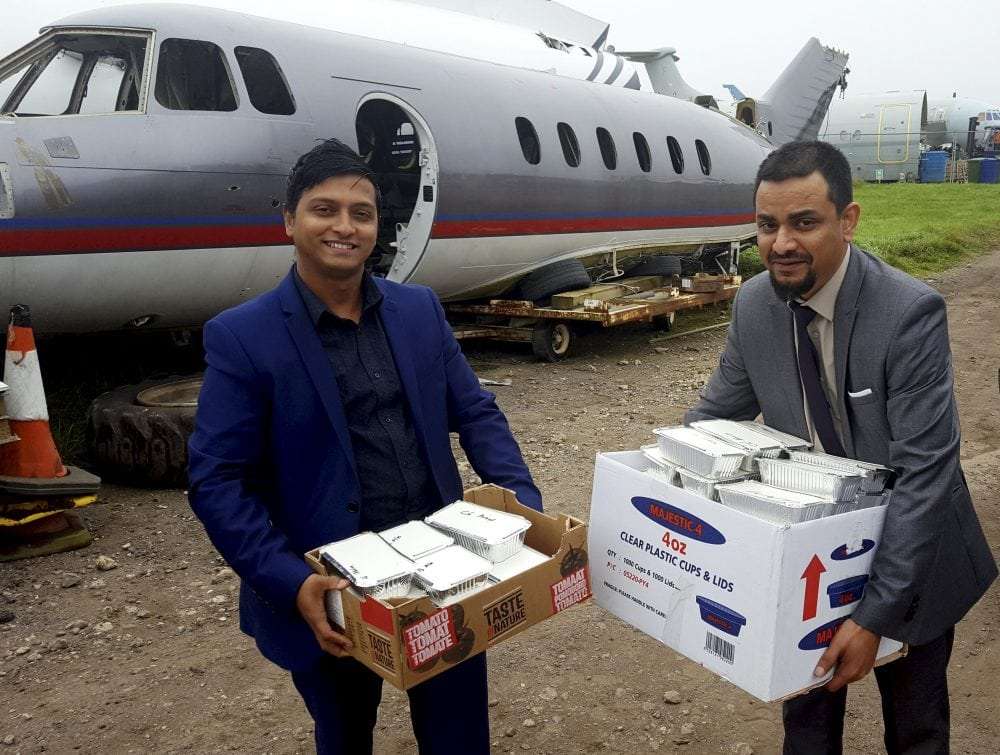 Shajahan Chowdhury (R) and Adnan Ahmed (L) delivering curry as payment for the plane. An indian restaurant boss with dreams of being a pilot has finally got his very own plane - after swapping it for 500 curries and 1,000 poppadoms. See ROSS PARRY story RPYCURRY. Shajahan Chowdhury bartered with the spicy fare to get his hands on the shell of 49-foot-long Hawker Siddeley HS125 jet which he now plans to turn into a restaurant. Aviation salvage company GJD Services were only too happy to swap the ex-charter jet for 150 vindaloos, 150 Bombay Aloos, 100 onion bhajis and a cockpit full of poppadoms. A promise of a further 200 tasty treats will follow on request. Mr Chowdhury , who is originally from Bangladesh, yearned to be a pilot when he was a young boy, is hoping to revamp to he plane so it looks like a private jet. As as chef he has worked all round the country, and during his career he has cooked for stars such as Cliff Richard, the Spice Girls. Aswad, Soul 2 Soul and Chaka Khan.
