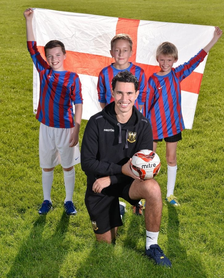 "PE teacher Sam Chambers, 24 from Weeden Bec Primary School near Northampton pictured with three of his players (from left: Will, Joe and Ewan. See Masons copy MNFOOTBALL: An unbeaten under-12s primary school football coach has applied for the England job and says he'd take it ""depending on how much money they offered"". If he got to the big spot, the ambitious football coach said his first port of call would be to ""take the boys out for a cheeky Nando's-anyone who cannot deal with Extra Hot is not playing for me"". Although it was a shame to lose Sam Allardyce, Sam Chambers said it just proved that the FA had appointed the wrong Sam first time around and is convinced he's the man for the top job. Ladbrokes gave him 1,000-1 odds of getting the top job after his first application for the job following the stepping down of Roy Hodgson."