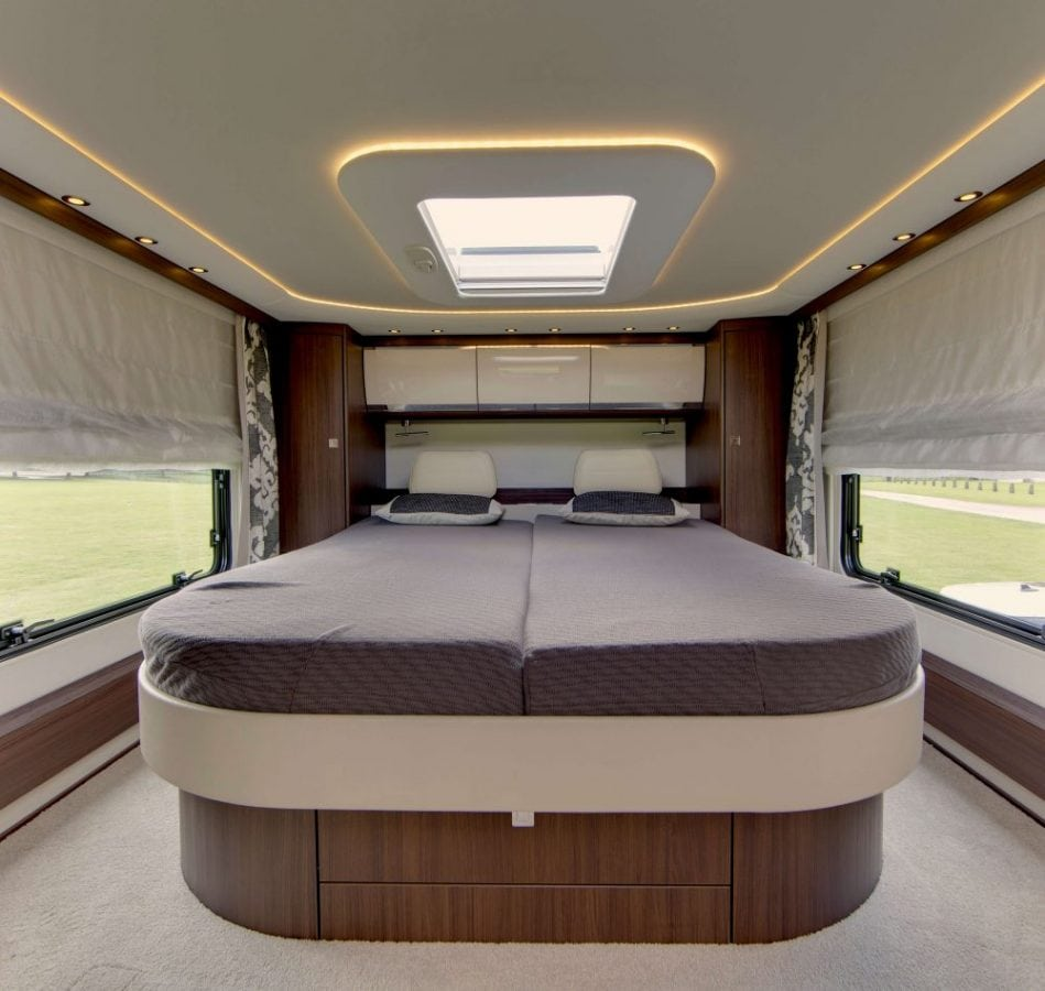 "The Morelo Empire Liner motor home. See SWNS copy SWMOTOR: A motorhome firm has unveiled a palace on wheels which costs almost twice as much as the average English house. The Morelo Empire Liner has underfloor heating, a rain shower, double bedroom and even a garage. It is powered by a 7.7-litre engine which develops 300bhp a twice as much torque as a Lamborghini Aventador. The motorhome, described as a ""super-liner"", has a whopping £378,200 price-tag, which is almost twice the price of the average home in England. It has a large panoramic roof which you look up at from the spacious double bed."