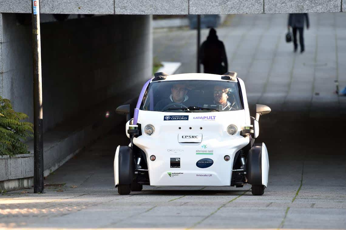 The first UK trials of a driverless car is seen on the streets of Milton Keynes. See MASONS story MNCAR: The UK's first driverless car hit the streets for the first time yesterday (tues) for trial tests which were deemed a success. The self-driving vehicles were being trialed carrying passengers while the cars operated entirely without human control. The two-seater pods, which are similar to Smart cars in appearance, are versions of the Lutz Pathfinder, the UK's first driverless car. They operate at speeds of up to 15mph without human assistance and follow routes from virtual maps.