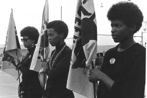 1-women-drilling-with-panther-flags-photo-courtesy-of-pirkle-jones-and-ruth-marion-baruch