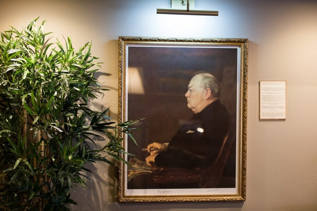 A portrait of Winston Churchill sat in a chair inside the cigar merchants is seen at James J. Fox cigar merchant in London. See National New story NNCIGAR; Cigar lovers celebrate the birth of Winston Churchill in one of the only indoors smoking rooms at London's oldest cigar merchant.