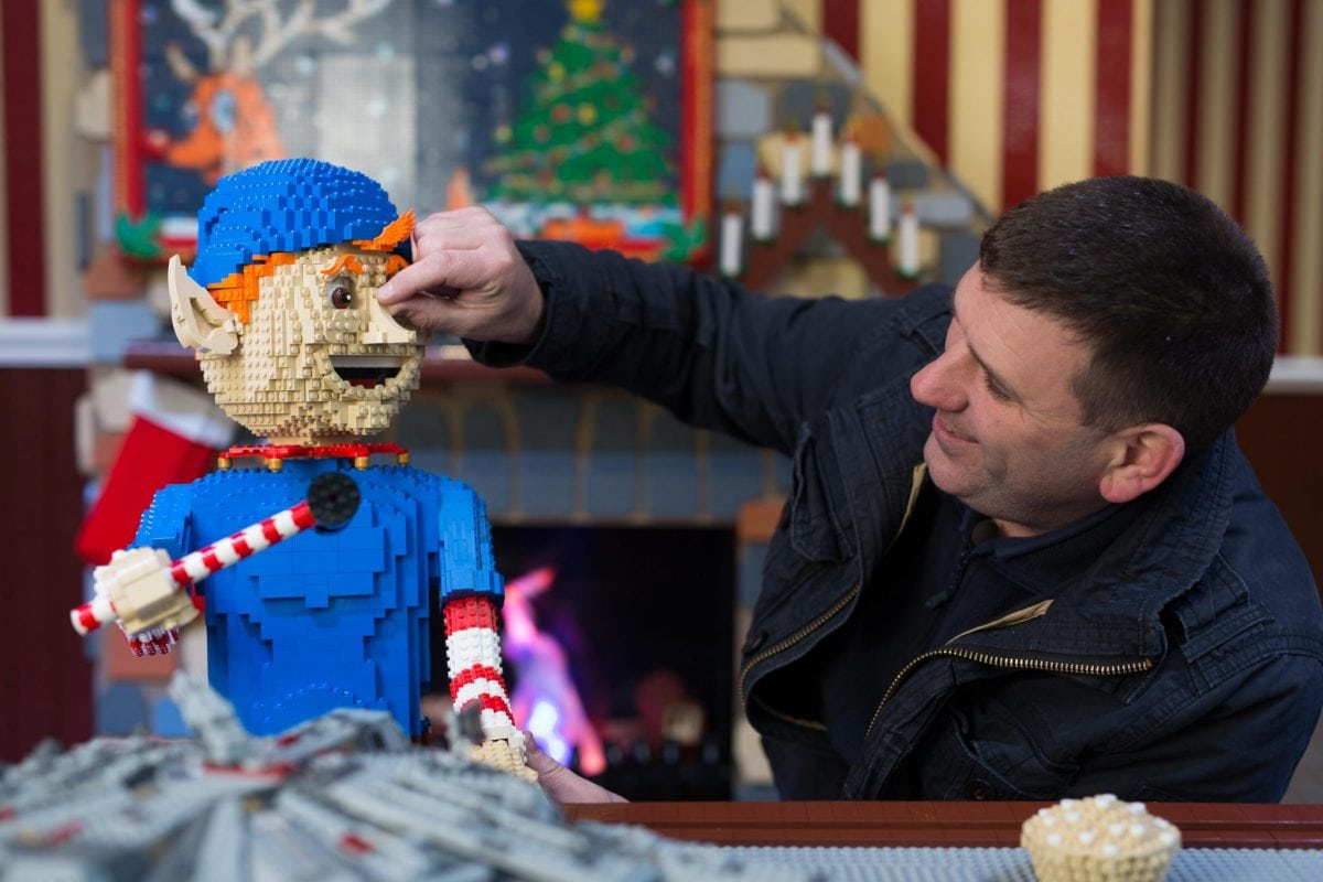 EDITORIAL USE ONLY Duncan Titmarsh the UK's only LEGO Certified Professional Builder puts the finishing touches to the LEGO Santa's Workshop in Covent Garden. PRESS ASSOCIATION Photo. Picture date: Tuesday November 29, 2016. The workshop which is made with over 700,000 LEGO bricks and features LEGO elves 'building' Christmas with Santa keeping a watchful eye will be open till 29th of December. #LetsBuildXmas Photo credit should read: David Parry/PA Wire