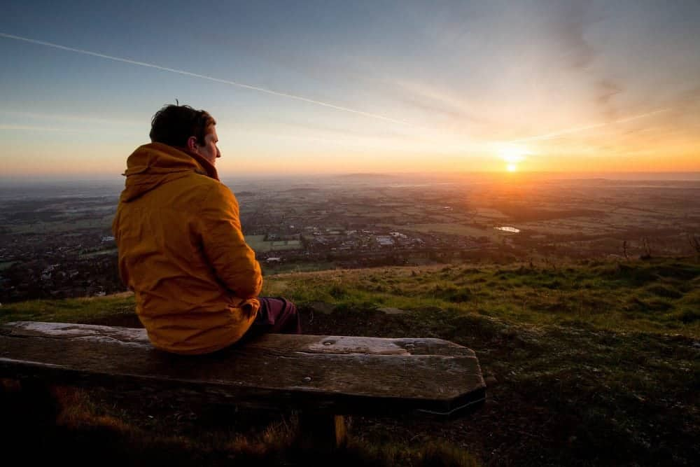 People watch a stunning winter sunrise over the Malvern Hills in Worcestershire. Although recent days have been mild for this time of year, a cold snap is expected to arrive in the next few days. December 27 2016.