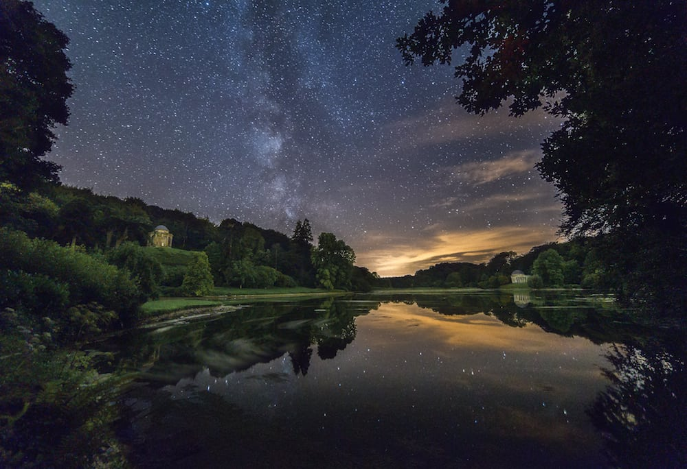 The stars are reflected in the still waters just after midnight over Stourhead Gardens near near Mere, Wiltshire. August 27 2016.