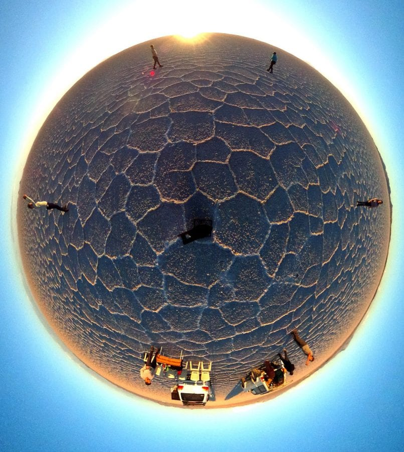 """One of Lee Thompson's 'Surroundies' on theUyuni salt flats in Bolivia. See SWNS story SWSURROUND; A daredevil photographer who captured the ultimate selfie at the top of the Christ The Redeemer statue now plans to better it by taking a """"surroundie"""". Lee Thompson, 34, has spent the last three months travelling around the world shooting incredible pictures on his Samsung's Gear 360. He has so far taken shots in Bolivia, Peru, India, Finland, and Sri Lanka as part of a marketing campaign for his company, Flash Pack. But the travel boss has his own wish list with top spot being taking a surroundie on top of the iconic Christ The Redeemer monument in Rio de Janeiro."""