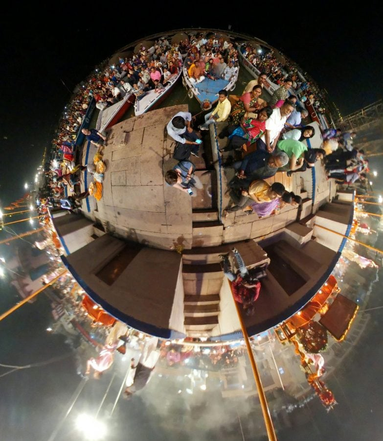 "One of Lee Thompson's 'Surroundies' on the river Ganges in Varanasi India. See SWNS story SWSURROUND; A daredevil photographer who captured the ultimate selfie at the top of the Christ The Redeemer statue now plans to better it by taking a ""surroundie"". Lee Thompson, 34, has spent the last three months travelling around the world shooting incredible pictures on his Samsung's Gear 360. He has so far taken shots in Bolivia, Peru, India, Finland, and Sri Lanka as part of a marketing campaign for his company, Flash Pack. But the travel boss has his own wish list with top spot being taking a surroundie on top of the iconic Christ The Redeemer monument in Rio de Janeiro."