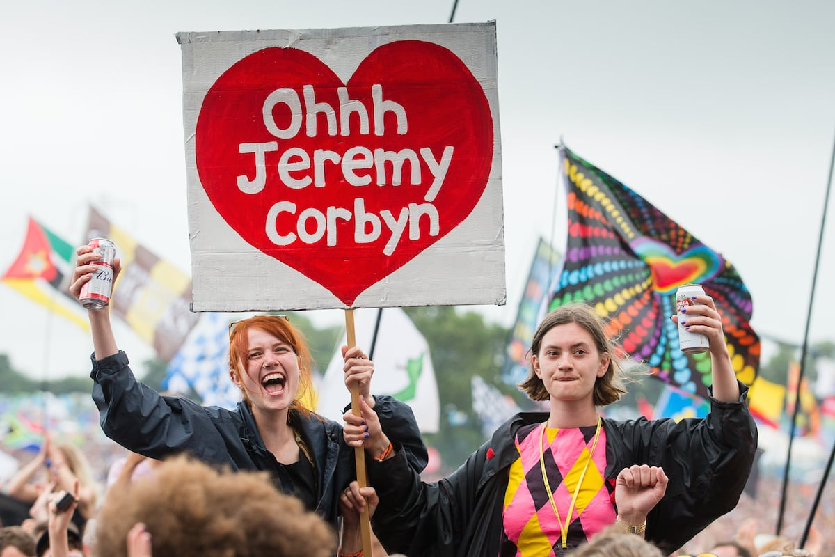 David Cameron unwittingly poses with a Jeremy Corbyn fan at Wilderness Festival