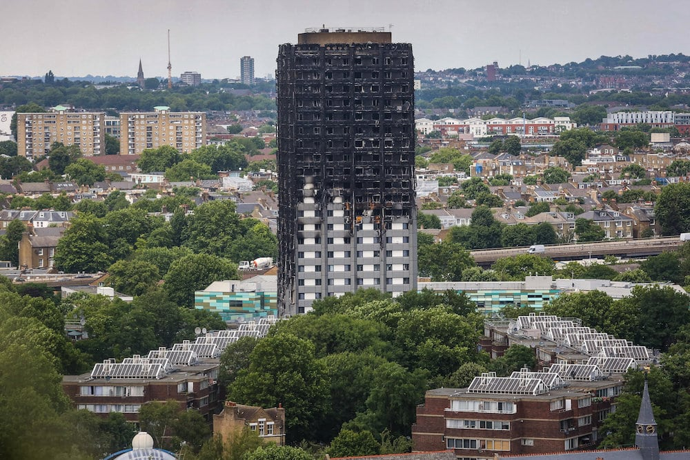 The charred remains of Grenfell Tower remains dominant in the landscape, a bleak memorial to some 80 residents who burnt to death when the apartment caught fire nearly a month ago, July 11 2017.