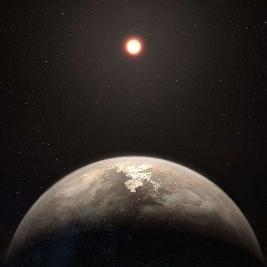 This artist's impression shows the temperate planet Ross 128 b with its red dwarf parent star in the background
