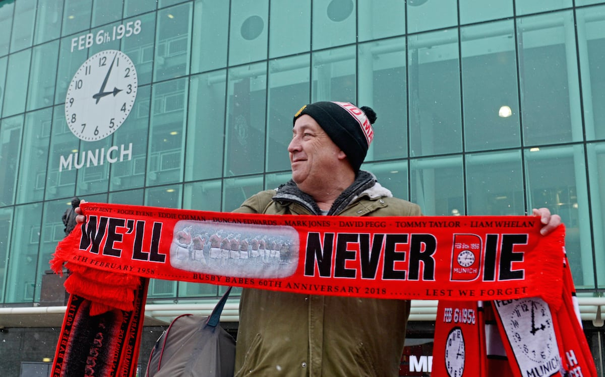 Munich Air Disaster memorial scarfs are sold outside Old Trafford football stadium on the 60th anniversary since the Munich air crash