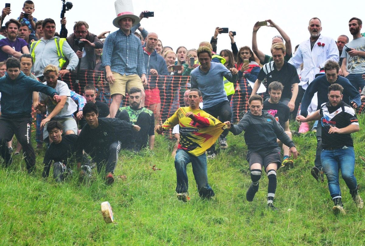 A soldier was named the gratest athlete in the world today after his record-breaking 21st win - at CHEESE-ROLLING. Legendary cheese-chaser Chris Anderson risked life and limb - well mainly limb - hurling himself into the record books for chasing a wheel of Double Gloucester down a super-steep hill.