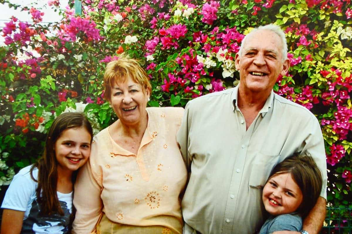"Collect of Brenda with her late husband Brian and their Grandchildren in the Seychelles. See NTI story NTIROYAL. A grandmother who is 18th cousin of the Queen is facing being deported back to South Africa after she was refused a visa to live in the UK. Brenda Ackerman, 71, traced her family tree back to the 12th Century which revealed her to be a distant relative of King John James 1st and Robert the Bruce. Mrs Ackerman was born in South Africa but fled in 2006 with her husband Brian after a string of burglaries. They moved to Dubai to be with their daughter Candice Gordon, 45, before finally settling in the UK in 2013 following the death of Mrs Ackerman's husband Brian. Last February, Mrs Ackerman applied for a long-term visa but it was turned down, despite her suffering from a pulmonary embolism and being in failing health. Mrs Ackerman's daughter has been granted permission to remain in the UK but the widow has now been informed she will be deported unless she returns to South Africa voluntarily. Mrs Ackerman, who currently lives with her daughter in Worcester, said: ""My descendants were British."