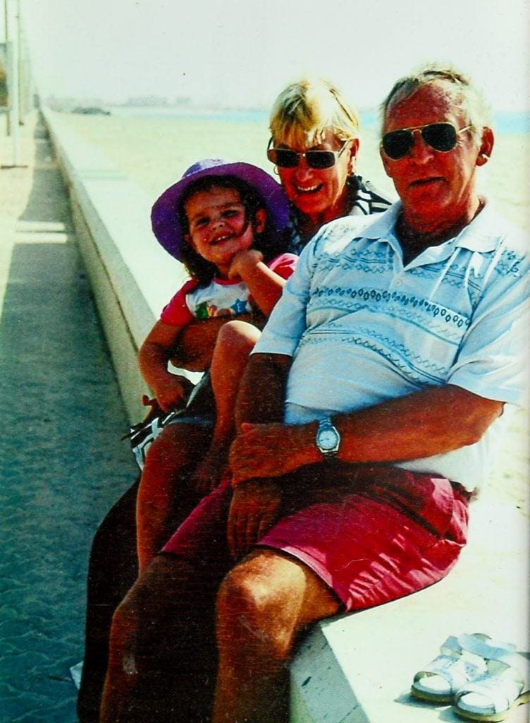 "Collect of Brenda with her late husband Brian and granddaughter in Dubai. See NTI story NTIROYAL. A grandmother who is 18th cousin of the Queen is facing being deported back to South Africa after she was refused a visa to live in the UK. Brenda Ackerman, 71, traced her family tree back to the 12th Century which revealed her to be a distant relative of King John James 1st and Robert the Bruce. Mrs Ackerman was born in South Africa but fled in 2006 with her husband Brian after a string of burglaries. They moved to Dubai to be with their daughter Candice Gordon, 45, before finally settling in the UK in 2013 following the death of Mrs Ackerman's husband Brian. Last February, Mrs Ackerman applied for a long-term visa but it was turned down, despite her suffering from a pulmonary embolism and being in failing health. Mrs Ackerman's daughter has been granted permission to remain in the UK but the widow has now been informed she will be deported unless she returns to South Africa voluntarily. Mrs Ackerman, who currently lives with her daughter in Worcester, said: ""My descendants were British."