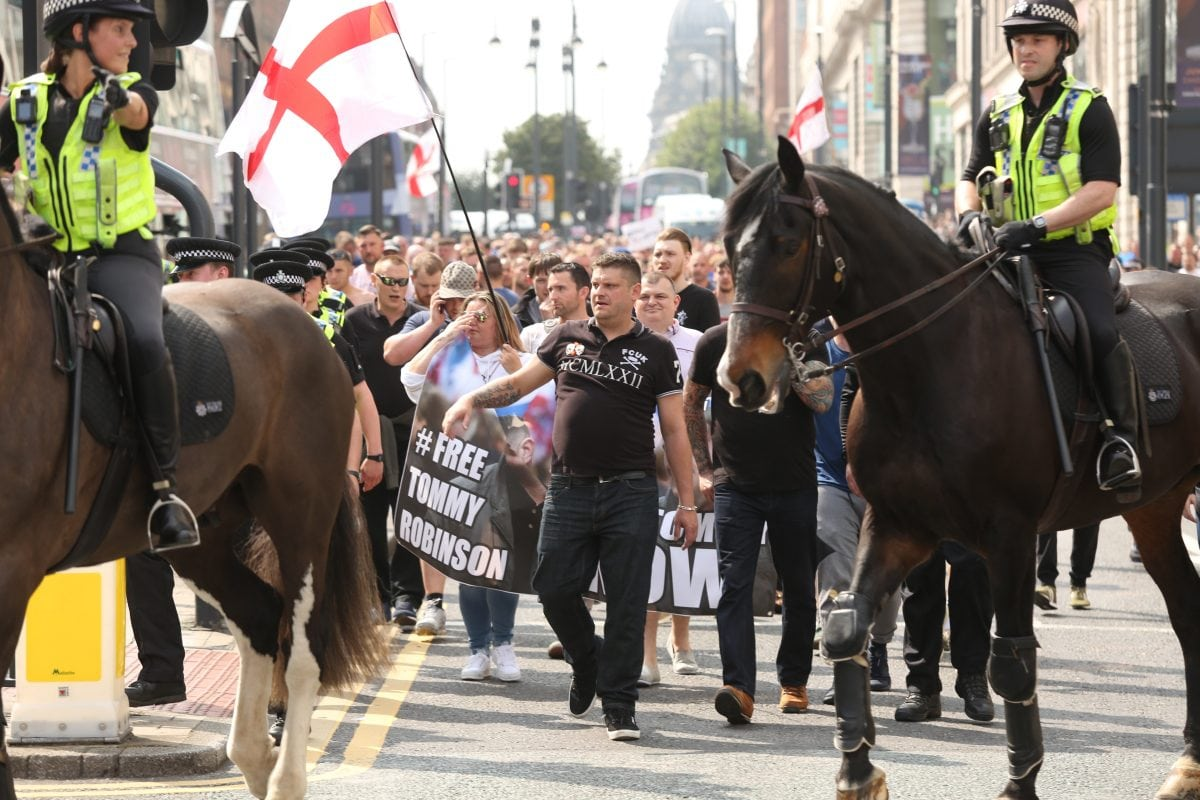 Around 400 Tommy Robinson supporters turned marched today to protest the jailing of the English Defence League founder. One supporter threw a red flare on top of the court building and a Dr Pepper bottle was thrown at a police officer. Despite Tommy