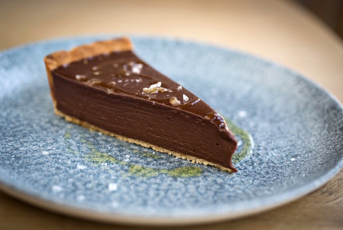 The Wife of Bath 'Bitter Chocolate Tart, Sevilano Olive Oil, Folkestone Salt'. Wye Kent