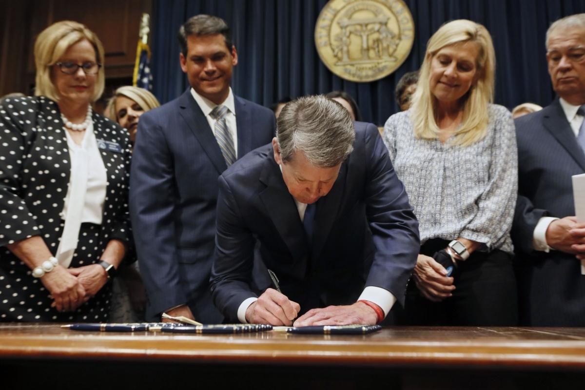 Brian Kemp signs the legislation