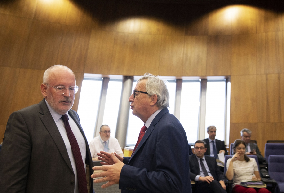 European Commission president Jean-Claude Juncker, right, speaks with Frans Timmermans